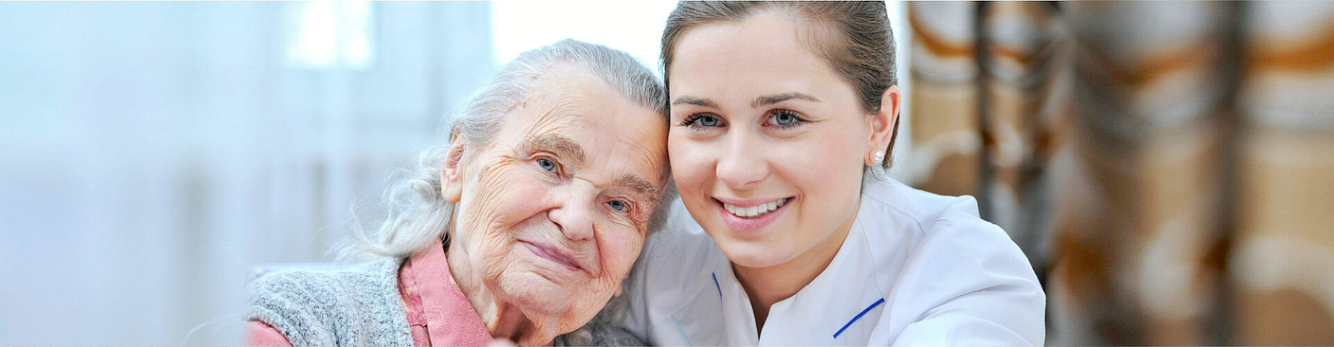 caregiver and senior woman are smiling